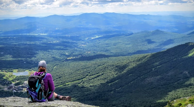 "Peaceful and content after a day's hiking, you're sure to enjoy the view from ""The Chin"" looking down on Stowe."
