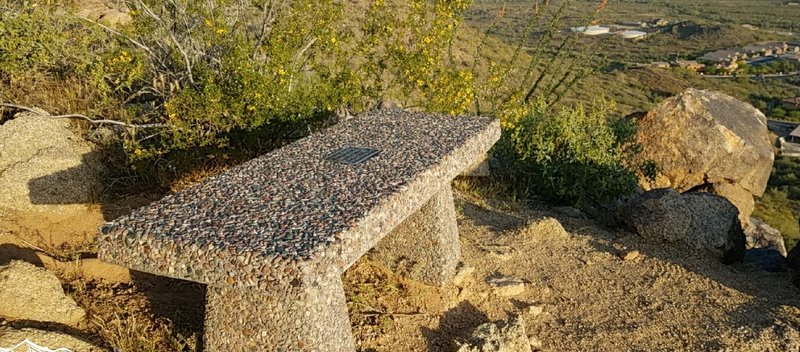 The Eastwing Mountain Trail hosts a pleasant memorial bench on which you can sit, reflect, and enjoy the view.