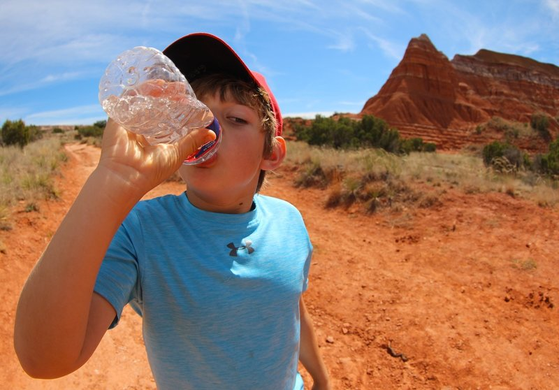 A parched Gabriel quenches his thirst on the Lighthouse Trail.