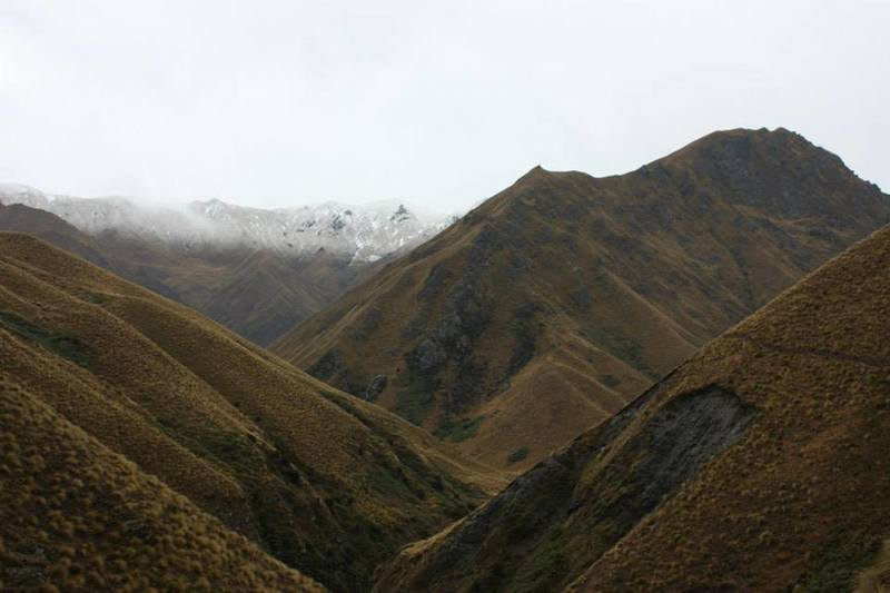 Steep tussock hills command the landscape.