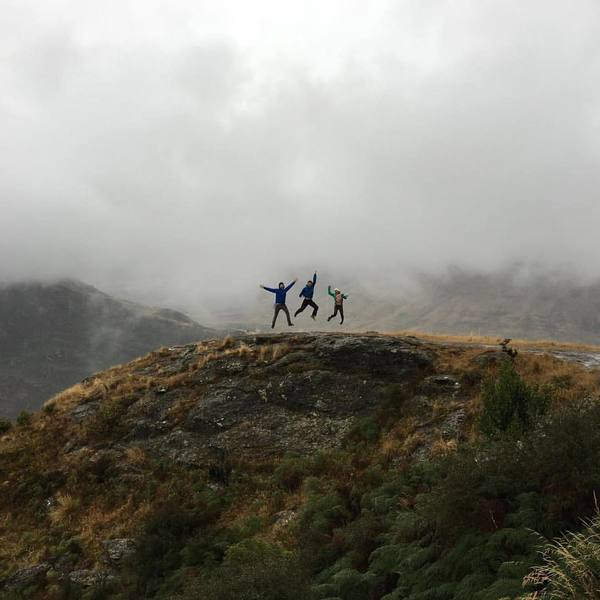 A group jumps for joy on the Diamond Lake Track.