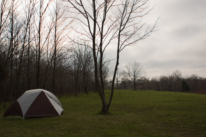 This campsite in Indian Caves State Park is pretty cushy and has great views of the grass and forest to boot!