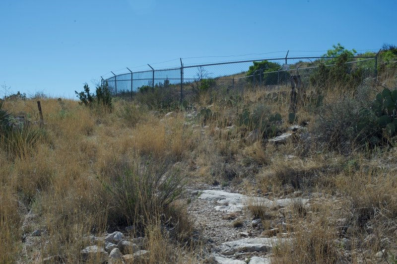 This fenced entrance was blasted into the cave so that the guano could be extracted and hauled to market.