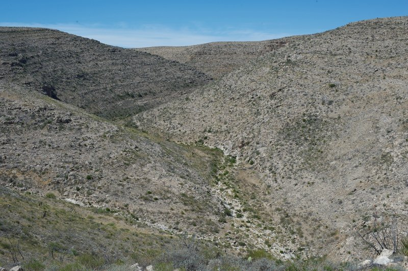 On the left-hand side of the trail, canyons can be seen weaving through the national park.
