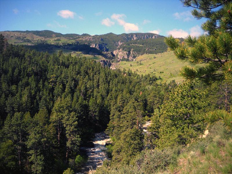The trail follows the Tongue River along a box canyon.