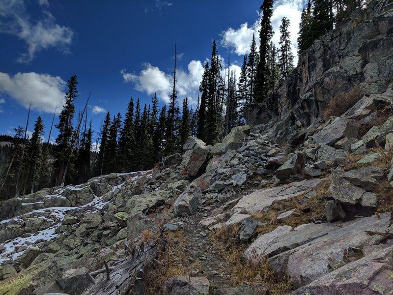The Grouse Creek Trail heads through the cliffs.