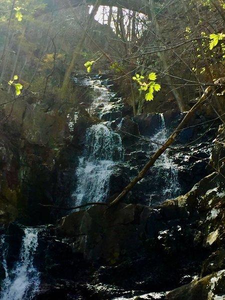 A scenic waterfall alongside the trail.