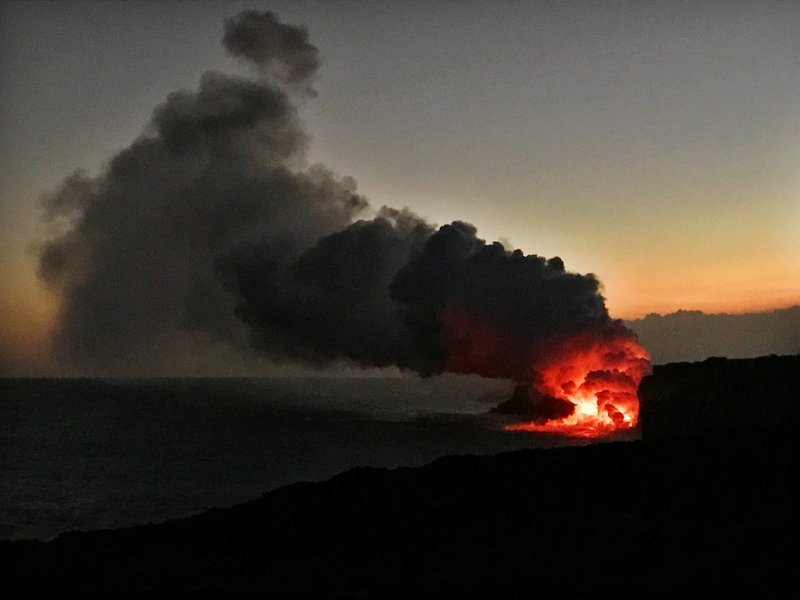 An epic sunset bolsters the view of lava flowing into the ocean from the edge of the flow in April 2017.