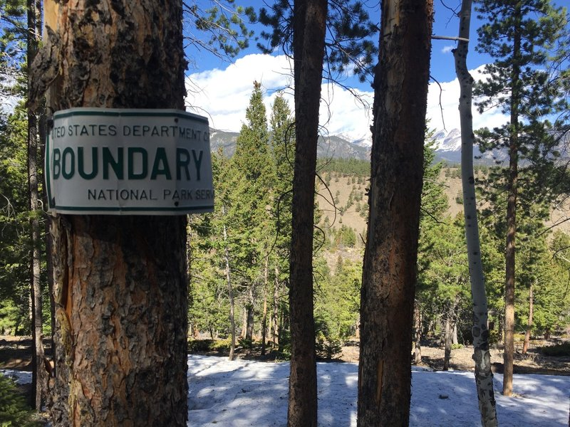 The NPS Boundary signs help with finding the snow-covered trail.
