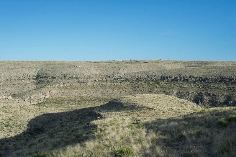 The Carlsbad Caverns Visitor Center sits on the hillside far across the canyon.