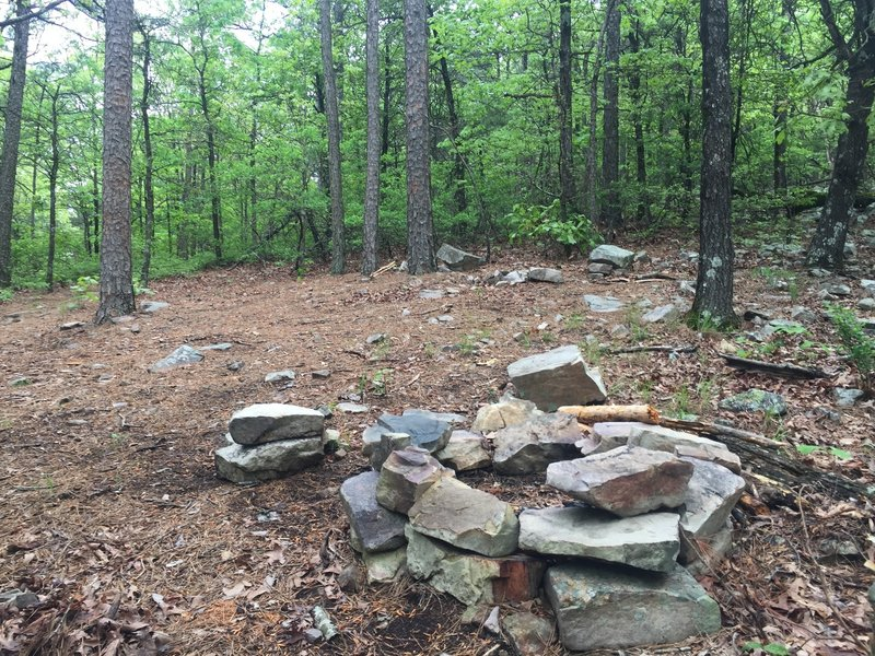 A primitive camping spot for weary travelers. Don't camp here. There are much better sites a few minutes away.
