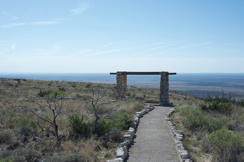 There is a small seating area with views of the New Mexico and Texas countryside from the top of the ridge.