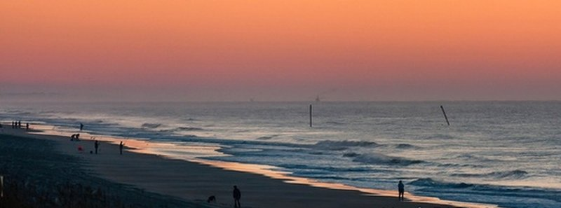 Looking north in Surf City, NC at the old pilings from the lost Barnacle Bills Pier.