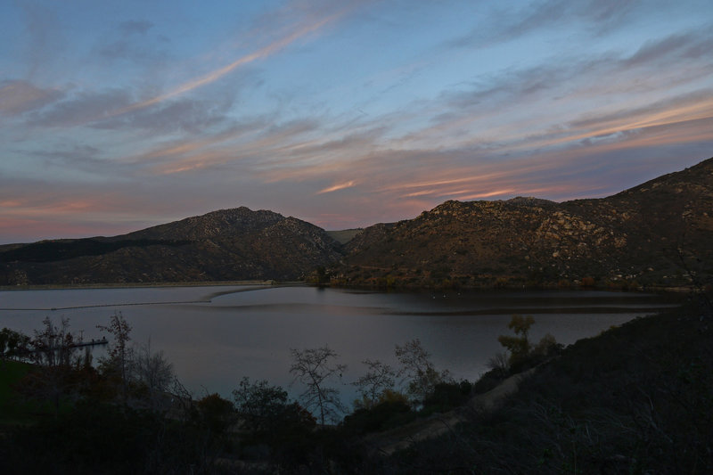 The sun sets over Lake Poway.