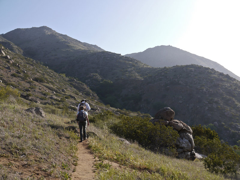 Hikers at Thelma and Louise rock early in the morning.