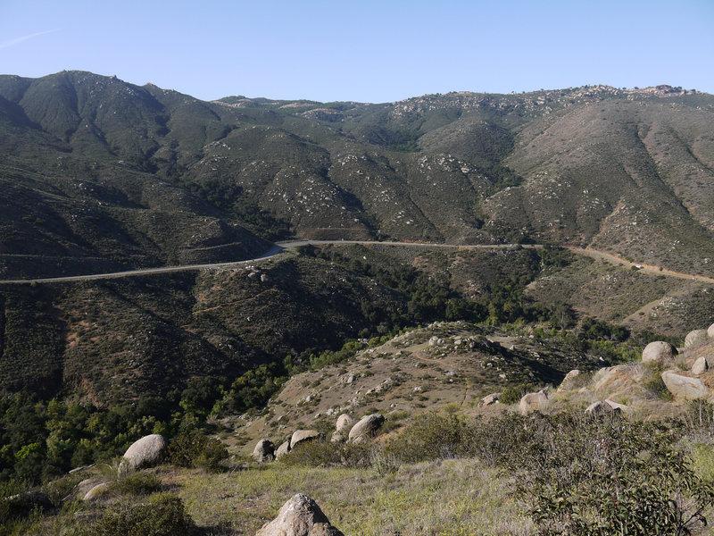 San Pasqual Valley Road snakes through San Pasqual Canyon above the San Dieguito river bed.