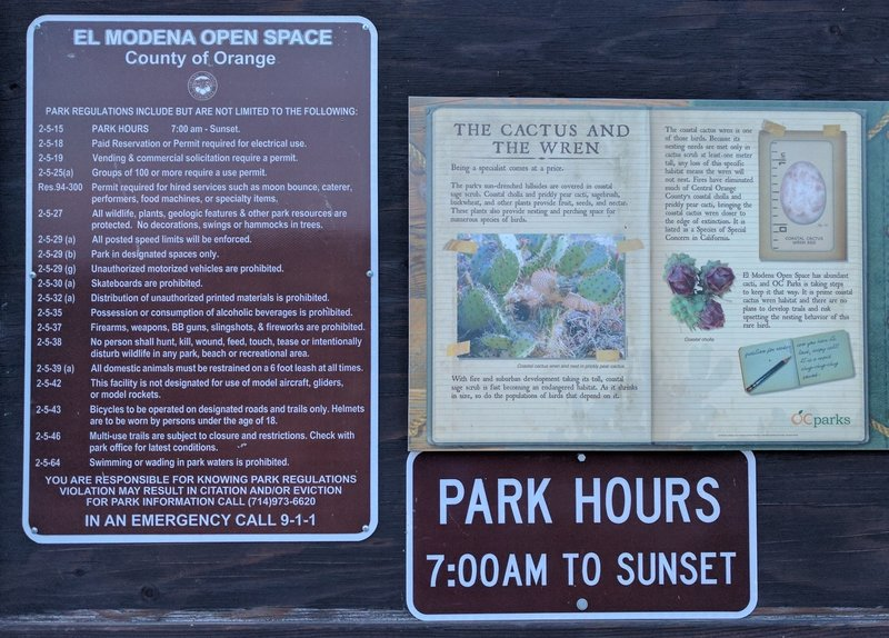 An informative kiosk provides park rules, regulations, and general info about the area's flora/fauna.