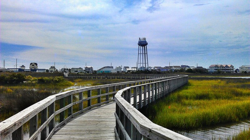 The boardwalk from Soundside Park heads to the grocery store and the main beach access.
