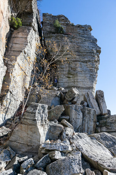 The trail is inundated with rockfall underneath the cliff.