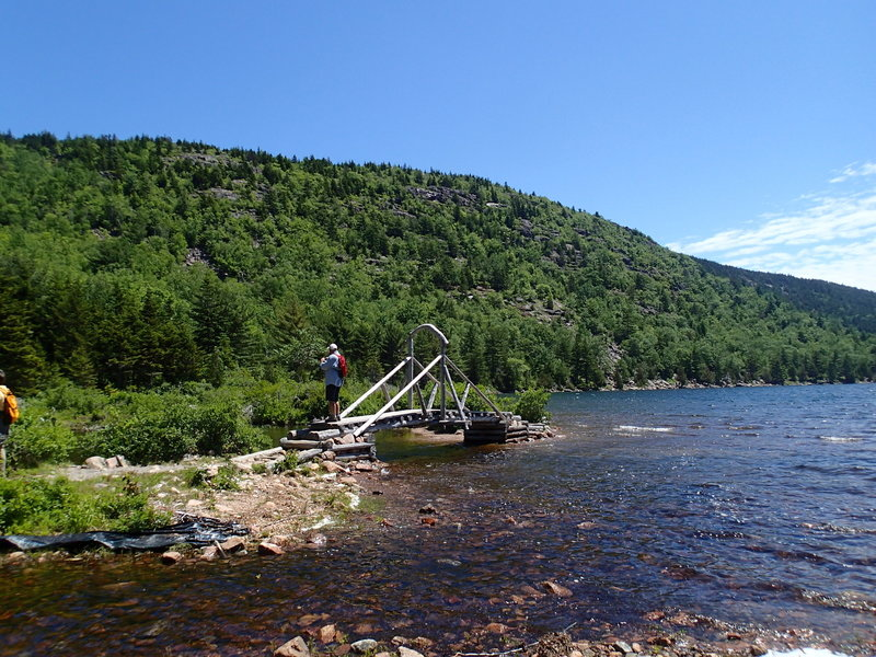 A small bridge aids your passage over the water near the north end of Jordan Pond.