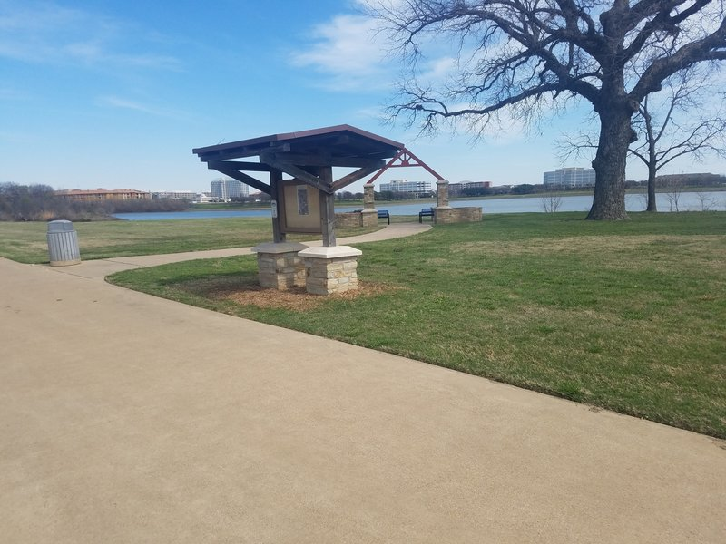 This view spans across a small lake just off of the Campion Trail in Keenan's Crossing Park. There's a nice seating area behind the informational kiosk.