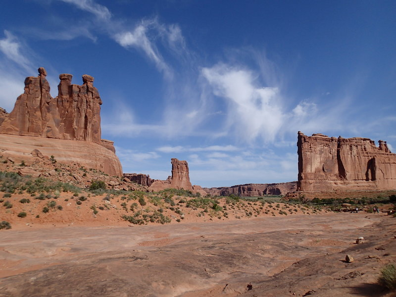 Three Gossips (R), Sheep Rock (C), and Courthouse Tower (L).