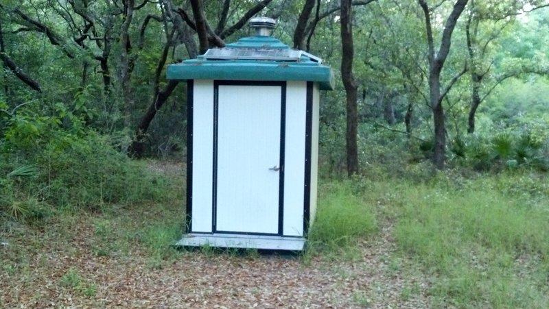 A porta-potty along the trail.