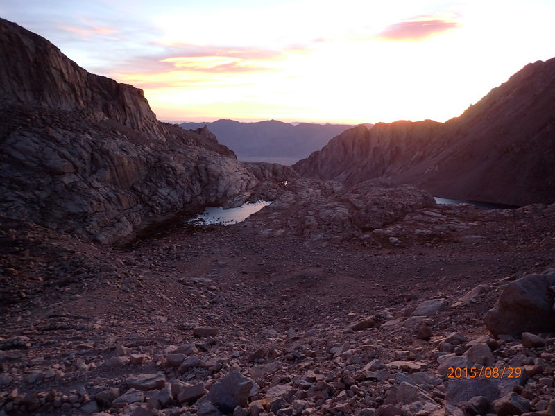 Daybreak looking down on Trail Camp from the middle of the 99 switchbacks. Can you find the tents?