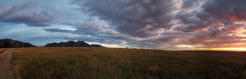 Sunrise and the Flatirons from the top of the hill on Flatirons Vista.