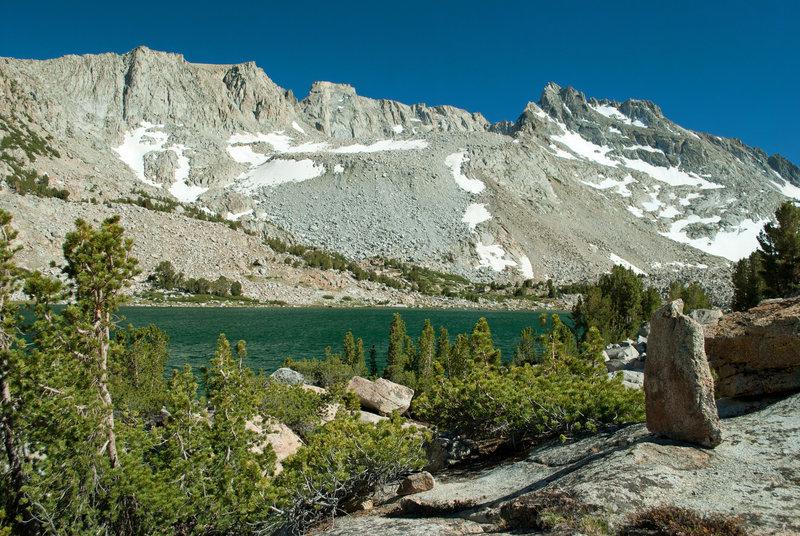 Moonlight Lake sits at the feet of towering granite cliffs.