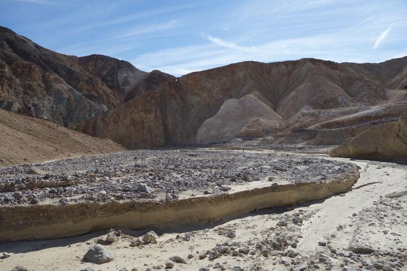 A wide sandy wash runs through Gower Gulch.