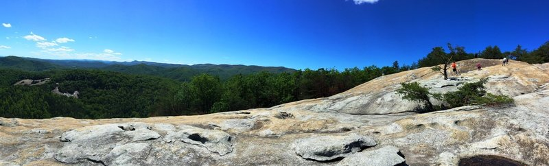The summit of Stone Mountain offers beautiful views of Wolf Rock in the background.