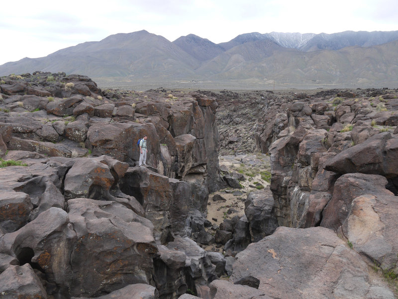 A hiker admires the top of Fossil Falls.