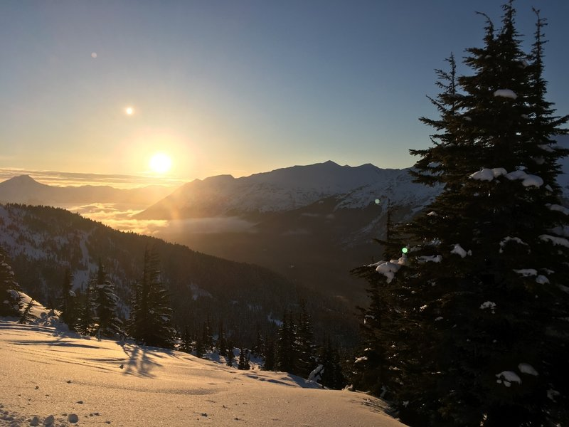 The sun sets over Mount Alpenglow and the Girdwood Valley.
