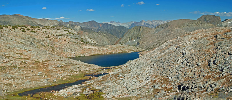 These are the lakes northwest of Peak 11493. You can make a fairly steep descent among the talus to the smaller lake in the foreground from the trail.
