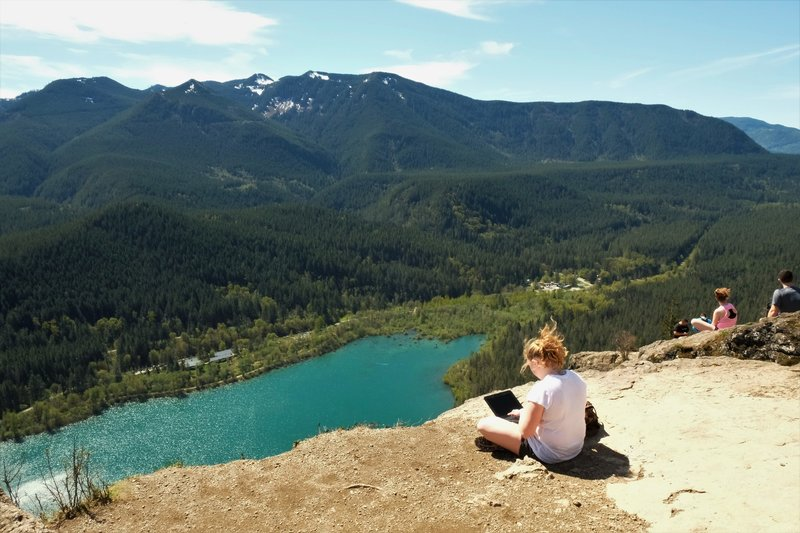 """I call this one """"Laptop Lady on the Ledge"""". Clearly, Rattlesnake Mountain is a popular and achievable hike."""