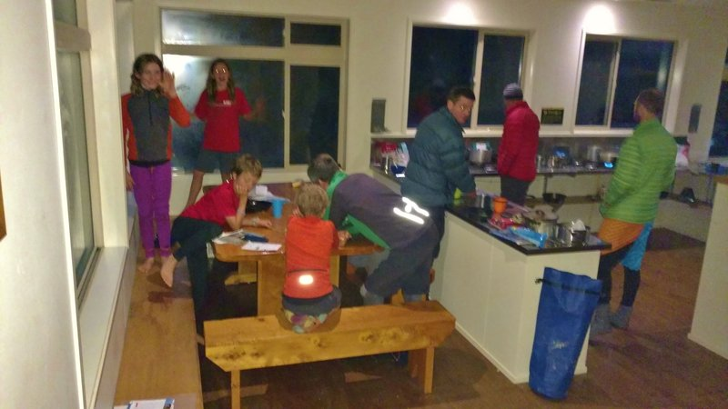 It's dinner time at the well-appointed Perry Saddle Hut on the Heaphy Track. It's May and the days are getting very short.