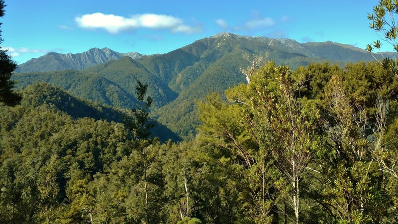 The Heaphy Track offers spectacular vistas overlooking the Aorere River Valley and the Tasman Mountains.