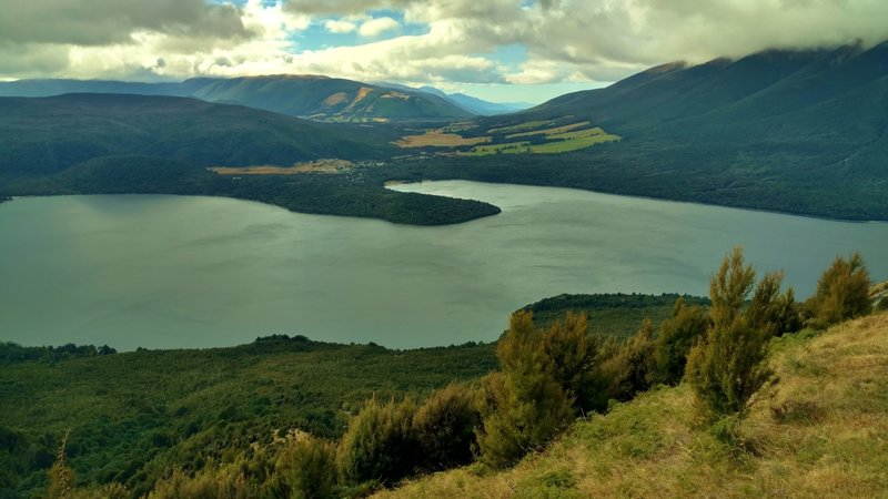 Lake Rotoiti is stunning. In the distance (center, with clear blue sky) is the valley of the Blenheim wine region.