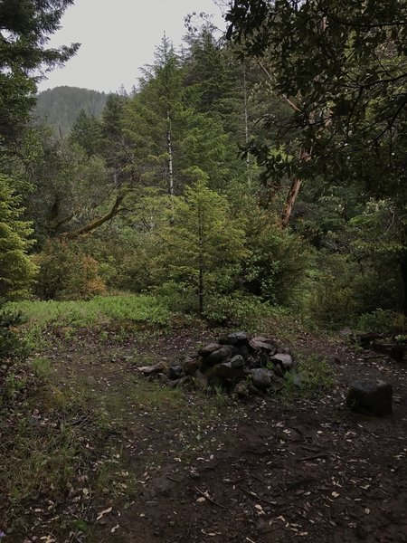 A fire ring marks an old campsite near the confluence of Craigs Creek and the South Fork Smith River.