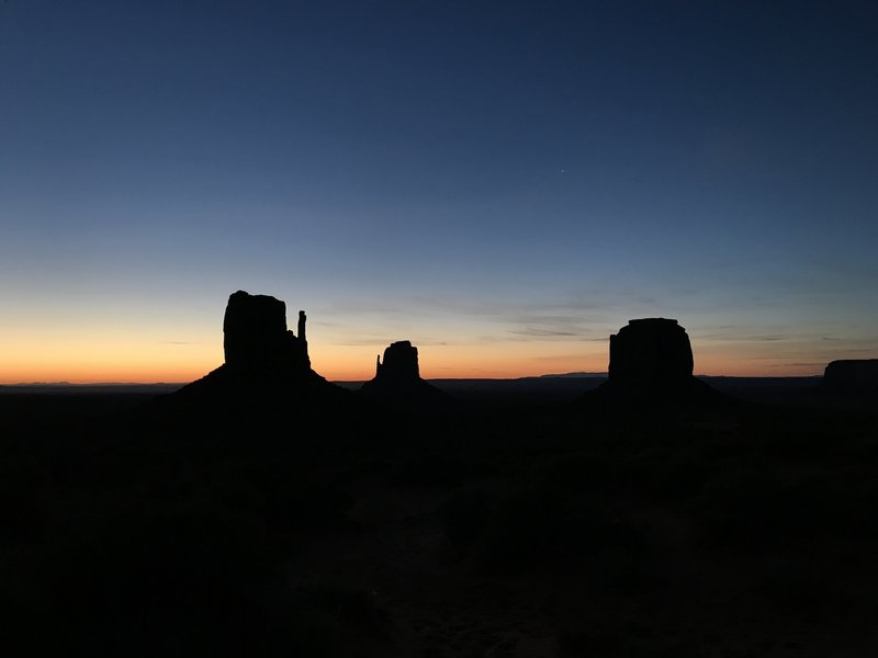 The sun rises over a sleeping Monument Valley.