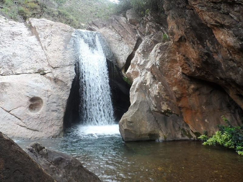 Ostra Waterfall cascades into the stream below.