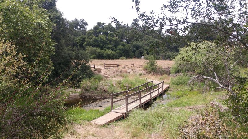 A footbridge aids your crossing near the Tenajas.