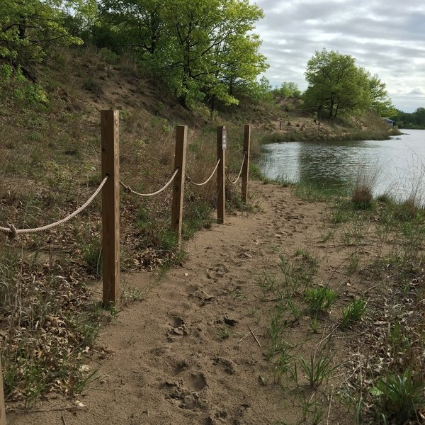 The trail winds around dunes and ponds.