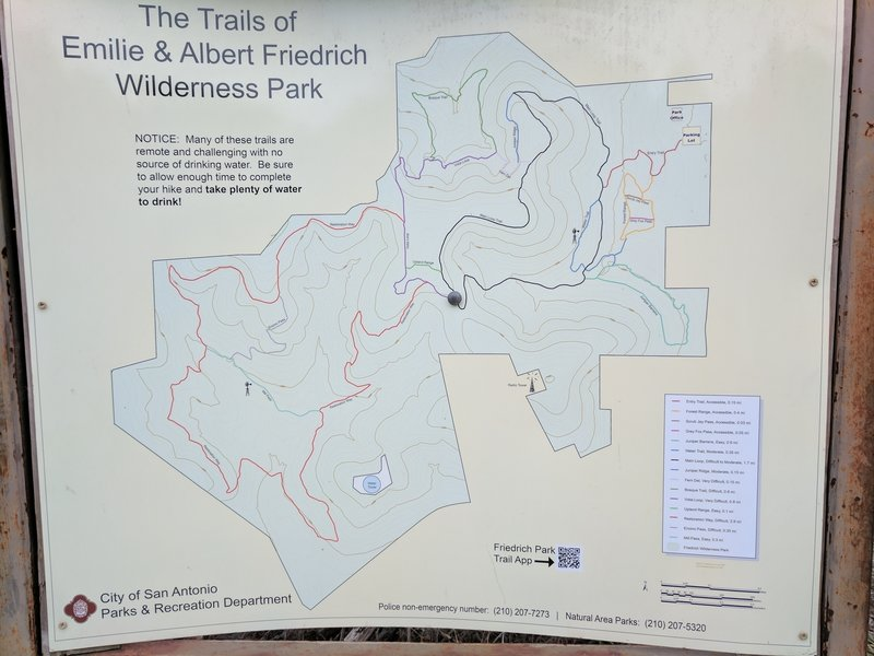 An informative trail map kiosk helps you find your way at this intersection.