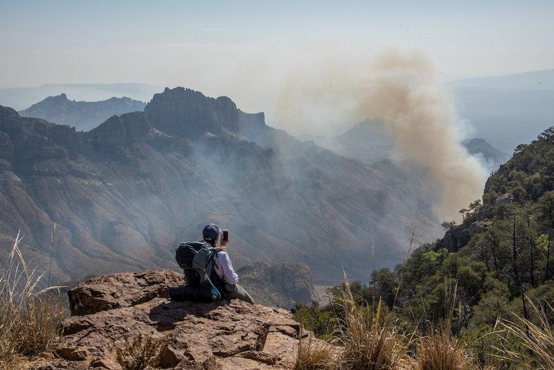 The Crown Mountain Fire burns below the Northeast Rim Trail.