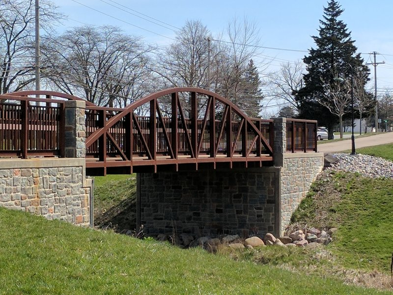A steel bridge aids your passage over this drainage.