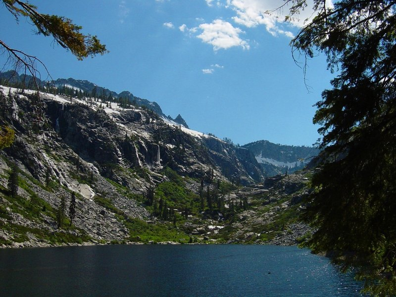 An alpine lake with waterfalls on the granite cliffs high in the Trinity Alps Wilderness Area in Northern California. from Prindleman under CC BY-SA