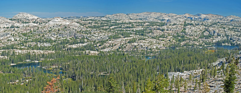 From the climb to Fawn Lake, the view shows all of Huckleberry Lake and a panorama of the Emigrant Wilderness.