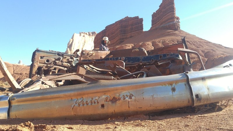A burnt out car still sits at the Tomsich Butte Trailhead.